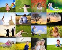 草地上快乐的小孩摄影高清图片