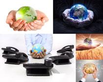 地球手心电话机摄影高清图片