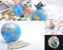 地球仪与货币摄影高清图片