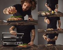 男人烤鱼摄影高清图片