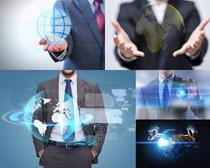 商务男士与地球摄影高清图片