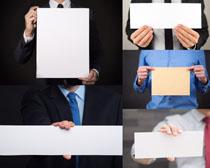 商务人物与广告牌摄影高清图片