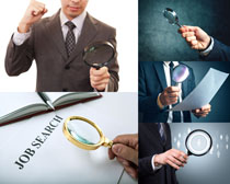 放大镜与商务男人摄影高清图片