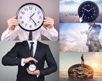 时钟与商务人士拍摄高清图片