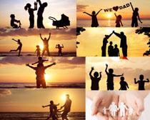 夕阳下一家人摄影高清图片