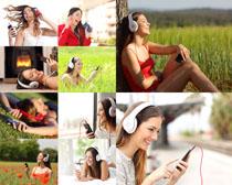 聆听音乐的女孩拍摄高清图片