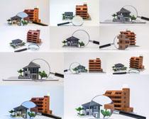 放大镜与模型房屋摄影高清图片