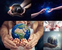 手心中的地球摄影高清图片