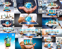商务平板上的建筑地球高清图片