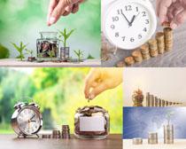 金融金币与时钟摄影高清图片