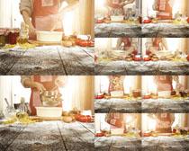 制作汉堡包的男人摄影高清图片