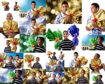 国外男孩手中礼物摄影高清图片