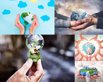 双手与地球环保摄影高清图片