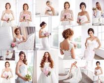 国外新娘手抱花朵女子摄影高清图片