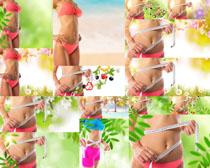 尺子與瘦身女子攝影高清圖片