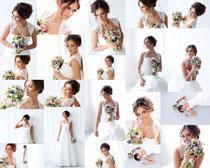婚纱美女手抱鲜花摄影高清图片