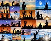 夕阳下的祈祷人们摄影高清图片
