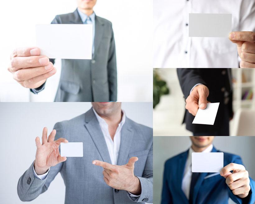 展示名片的商务人士摄影高清图片