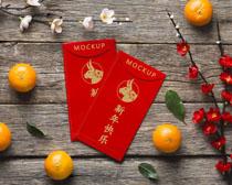 新年红包花朵桔子装饰PSD素材